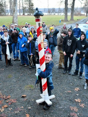 """Members of Boy Scout Troop 55, from Ellis Hollow, line up to celebrate with the """"Duck"""" awarded to their Pigeon Hole Patrol, which came in first place at this year's Taughannock District Winter Camporee."""