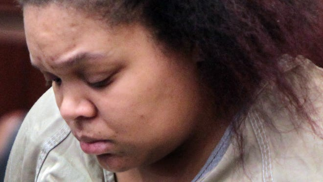 Andrea Bradley waits in court before Wednesday's hearing.