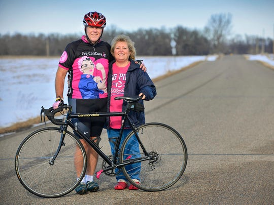 "Al and Terry Reszel, Richmond, stand Sunday, Jan. 31 with the bike Al plans to use to cycle from Afton to Chicago during a week in June to raise awareness and funds for breast cancer research. Reszel's wife, Terry, is a breast cancer survivor. Al Reszel, 57, organized the ride that will raise funds for the Breast Cancer Research Foundation titled ""Pink Pedals for a Cure: Terry's Ride 2016."""