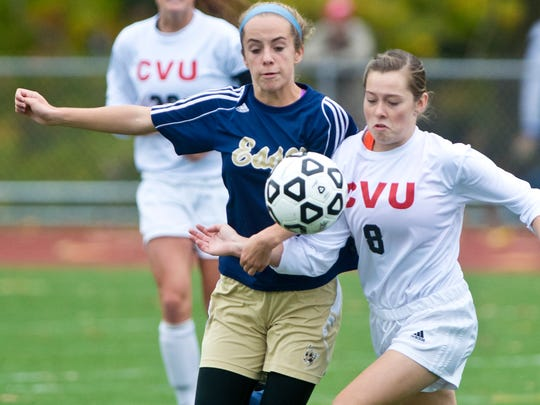Essex's Olivia Malle , left, and Champlain Valley's Mackenzie Buckman close on the ball during last year's state championship game in Burlington.