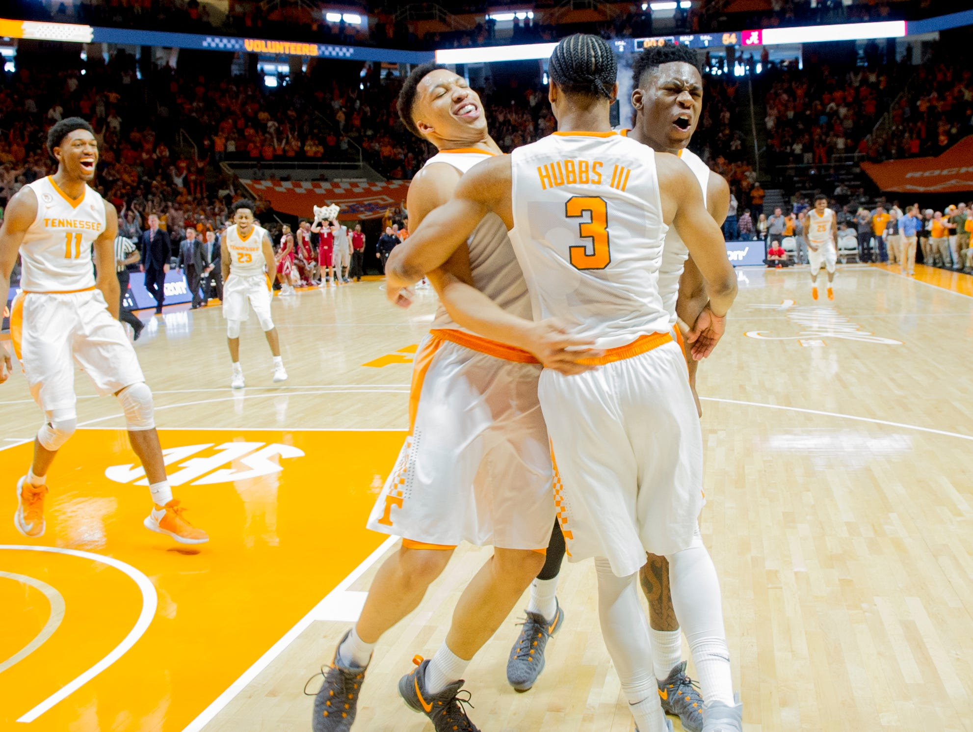 Tennessee's Robert Hubbs III (3) celebrates with Grant Williams and Admiral Schofield after the Vols completed a comeback victory over Alabama on March 4, 2017, at Thompson-Boling Arena.