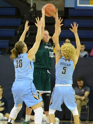 UW-Green Bay forward Mehryn Kraker fights through full-court pressure from Marquette's Isabelle Spingola and Natisha Hiedeman.