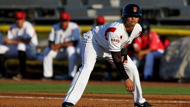 Volcanoes second baseman Richard Rodriguez leads off of first base against Tri-City at Volcanoes Stadium, on Tuesday, July 7, 2015, in Keizer, Ore.
