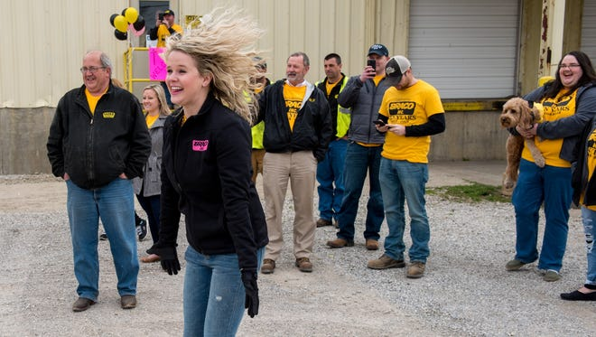 Braco Inc. boss Brittany Hazelwood jumps for joy as the custom-order pink truck is unveiled at an open house celebrating her company's 10-year mark.