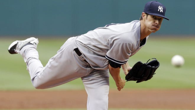 Yankees starting pitcher Shane Greene delivers in the first inning against the Cleveland Indians on Monday night.
