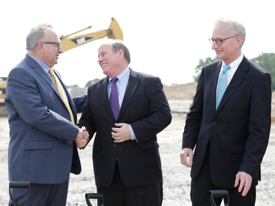 Doug Meijer, left, shakes hands with Detroit Mayor Mike Duggan as Meijer Co-Chairman Hank Meijer stands at right. The Meijers, who made Forbes magazine's 2015 list of billionaires,  hosted an official groundbreaking of it's second Detroit store at the former location of Redford High School on Grand River Monday June 30, 2014.