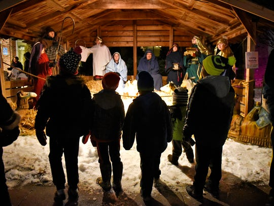 People view the living nativity presented by Messiah