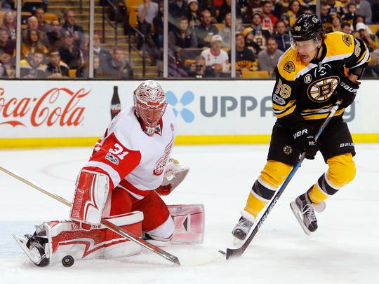 Red Wings goalie Jared Coreau makes a save as Bruins
