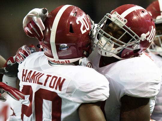 Alabama linebacker Reuben Foster (10) celebrates with Alabama linebacker Shaun Dion Hamilton (20) after Hamilton intercepted a pass during the first half of the SEC Championship football game between Alabama and Florida on Saturday, Dec. 3, 2016, in Atlanta, Ga.
