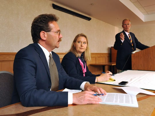 Attorneys Matthew Theil, left, Gilion Dumas, center, and Kelly Clark address the media during a 2011 press conference in Great Falls, Mont., where they announce a civil lawsuit against the Montana Council of the Boy Scouts of America on behalf of adult women who were sexually abused as children.