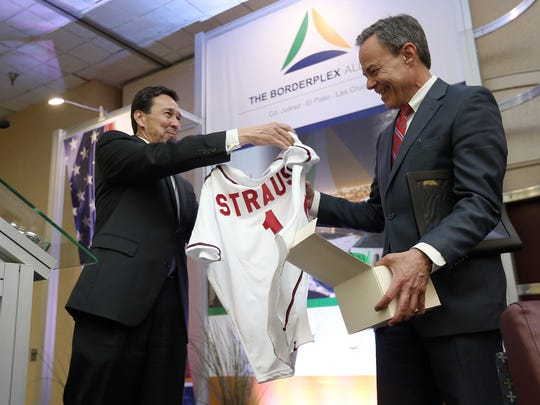 The Borderplex Alliance CEO Jon Barela presents Texas Speaker of the House Joe Straus with a personalized El Paso Chihuahuas jersey after Straus spoke in the Distinguished Speaker Series at the Wyndham Hotel Monday.