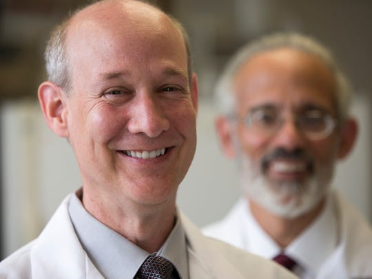 Dr. Kenneth White (left), Professor of Medical and