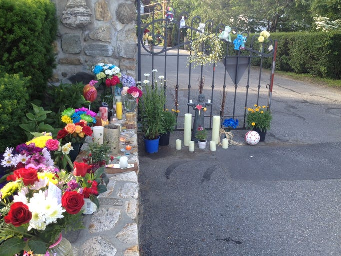 A makeshift memorial for Jenna Nolan at the  entrance to the gated community in Mahopac on June 21, 2014.