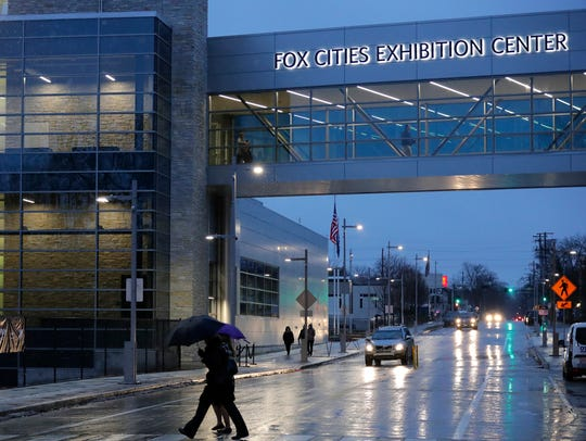 Residents make their way to the Fox Cities Exhibition