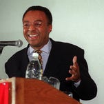 -__-BY SAM UPSHAW JR., THE C-J_Pulitzer Prize-winning author Clarence Page injected some humor into his speech last night at the University of Louisville. (COLOR PHOTO)-__-Text: PAGE/11-18-97/UPSHAW PHOTOPulitzer prize winning author Clarence Page injected a little humor in his presentation at UofL's Bigelow Hall. He talked about his book the Great Divide: The Resegregation of America.