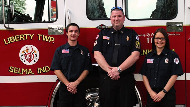 Pictured in front of a Liberty Volunteer Fire Department fire truck are (from left) Samuel Mauller, Chief Randy Ried and Kristen Clairday. Mauller and Clairday are local students who helped to write the grant application for the department's new air compressor.