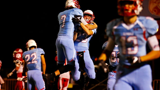 Glendale High School quarterback Alex Huston (7) and wide receiver Nader Leali (23) celebrate after Leali scored a touchdown during first quarter action of the playoff game between Glendale High School and Ozark High School at Lowe Stadium in Springfield, Mo. on Nov. 4, 2016.