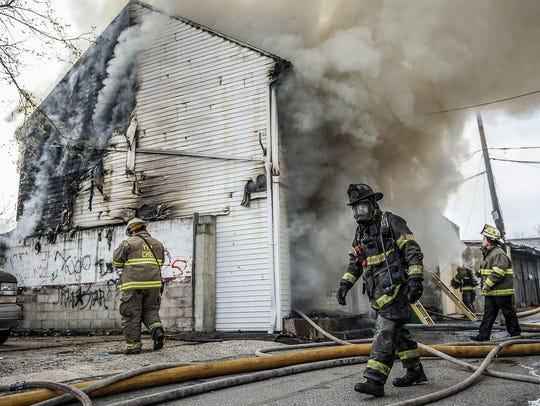 York City Firefighter Ivan Flanscha walks out of a