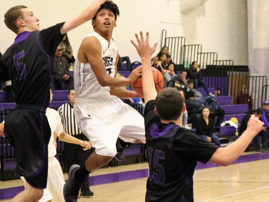 Mescalero's Matias Lapaz attempts a layup in heavy