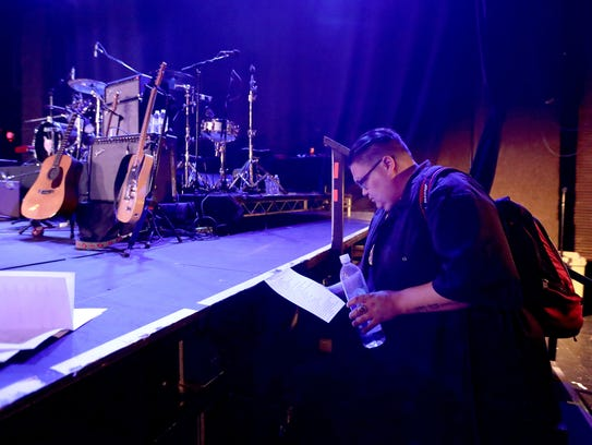 Jon Wheelock checks the set list to see when he will
