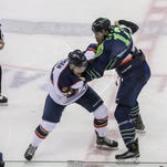 Cody Ferriero, left, of the Pensacola Ice Flyers battles for the puck against Nick Schneider of the Peoria Rivermen in first period action during their game Saturday night at the Pensacola Bay Center.
