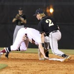 Tate's Hunter NeSmith slides safely back to second base before Milton's Justin Barr can make the tag during the Region 1-7A semifinal game Tuesday night at Tate High School.