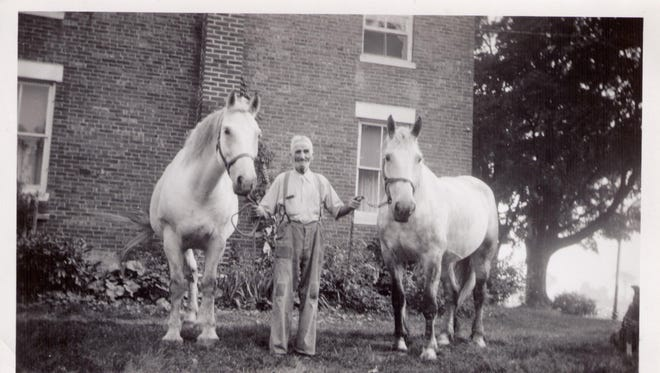 In this 1946 family photo provided by Gary Shaw via publisher Tordis Ilg Isselhardt, George G. Shaw, who spent years in the Canadian Yukon during the gold rush of the 1890s, poses with horses his home in Bridport.