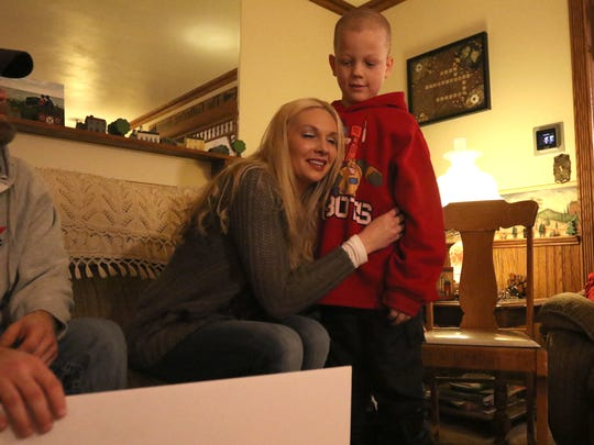 Bethany Rein embraces 8-year-old Ronan Mateer, during the first face-to-face meeting between the Mateer family and the Rein family, on Tuesday, November 15, 2016 in Wisconsin Rapids.