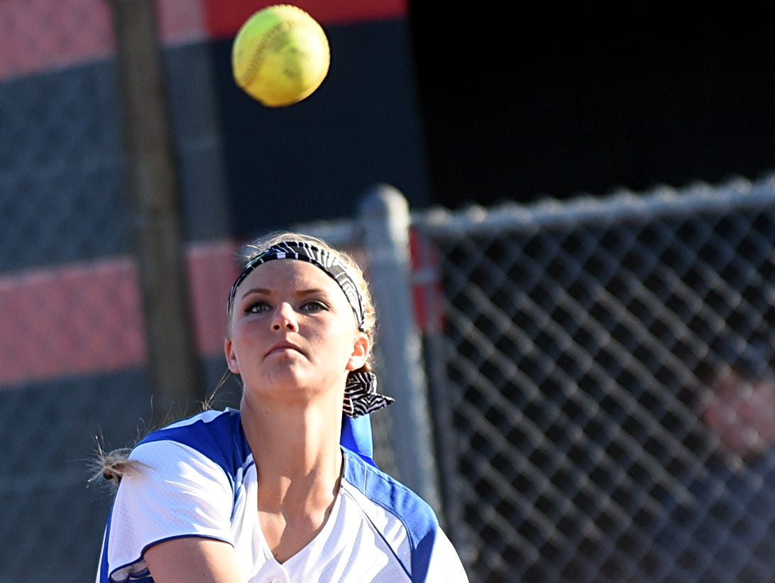White House High senior pitcher Madisen Adkins throws to first base for a sixth-inning putout.
