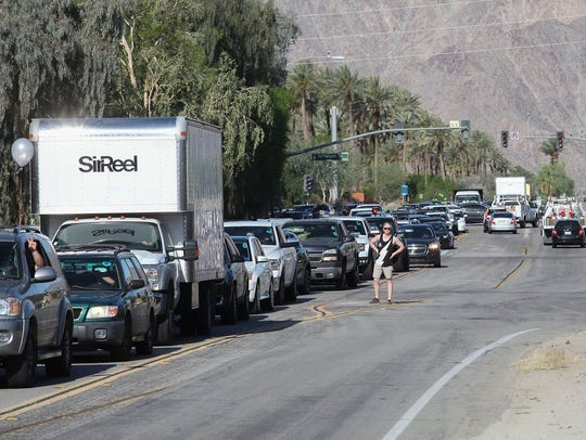 Coachella festivalgoers wait in traffic before the festival on April 13, 2017. The city of La Quinta is working with Indio and festival producer, Goldenvoice, to mitigate traffic issues and lessen the impact on its residents.