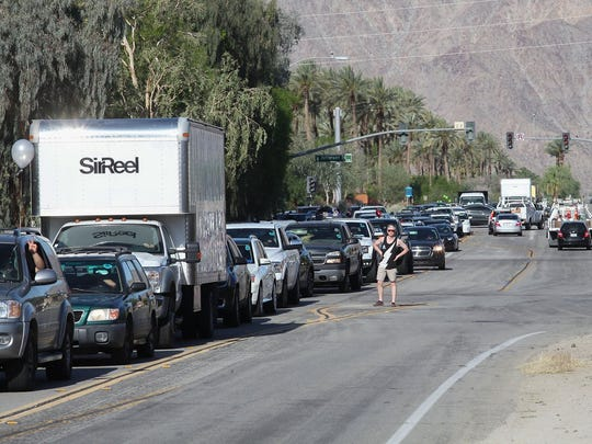 Coachella festivalgoers wait in traffic in April 2017, the Thursday before that year's music fest began.
