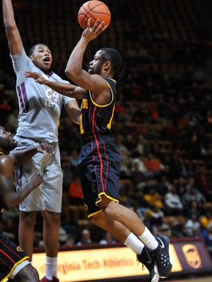 Grambling State Tigers guard ArnoldRichmond (11) shoots against the Virginia Tech Hokies in the first half at Cassell Coliseum. Virginia Tech defeated Grambling State 87-52. Mandatory Credit: Michael Shroyer-USA TODAY Sports