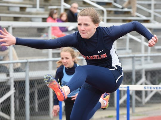 Franklin's Nikki Hawthorne eyes the next hurdle during Friday's Livonia City Championships meet.