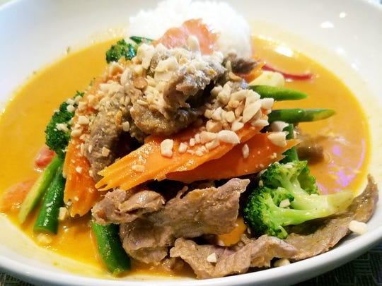 Emman's Asian Gourmet's Panang with beef had a coconut cream based curry with a stunning coral color. It was served with cut vegetables and a fragrant jasmine rice.