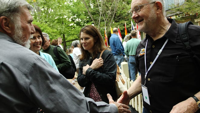 """Silver Dollar City has made a documentary film  titled """"Jack and Pete Tell It All."""" Peter Herschend, co-founder of the theme park, right, talks with, from left, Lloyd Lewallen and his wife, Rhonda, and Heather Stewart, at Silver Dollar City's 50th Birthday celebration Saturday, May 1, 2010. Lloyd Lewallen worked at Silver Dollar City from the beginning, and remembers putting bumper stickers on cars for $2 a day."""