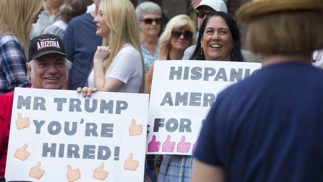 Frank and Brandy Baron, of Phoenix, wait in line to hear Republican presidential candidate Donald Trump speak at Phoenix Convention Center.
