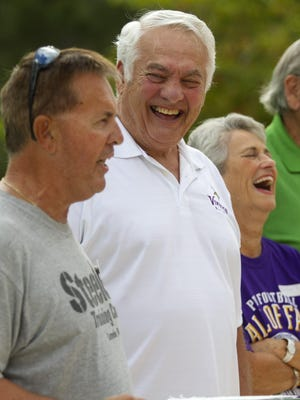 Amanda Inscore/The News-PressMick Tingelhoff and his wife, Phyllis, share a laugh while their neighbor Ken Cherry, left, recounts Tingelhoff's NFL accomplishments. Cherry is attending the Pro Football Hall of Fame ceremony for Mick Tingelhoff on Saturday in Canton, Ohio.