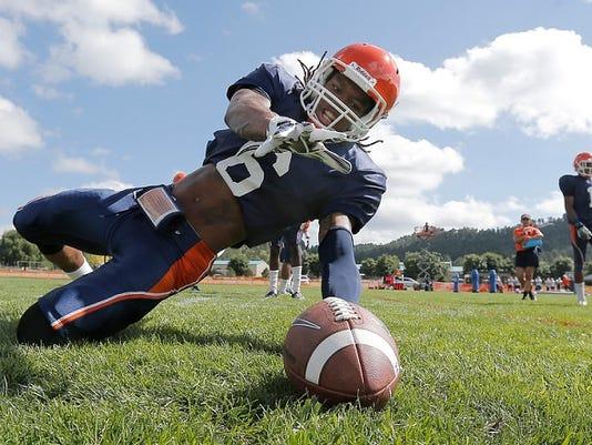 UTEP wide receiver Brandon Moss participates in a loose-ball drill at Camp Ruidoso.