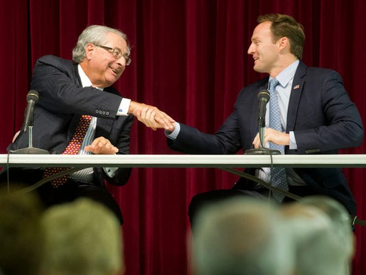 U.S. Rep. Patrick Murphy, right, and Republican challenger, Carl Domino, left, shake hands after a forum Oct. 12 at the Nettles Island club house in Jensen Beach. (MOLLY BARTELS)