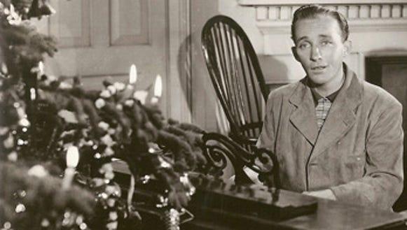 "Bing Crosby sings ""White Christmas"" in the movie ""Holiday Inn."""
