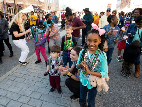 Children dance during the Montgomery Downtown Business Association's  3rd Annual Mardi Gras Block Party and Cajun Cook Off in Montgomery, Ala. on Saturday January 30, 2016.