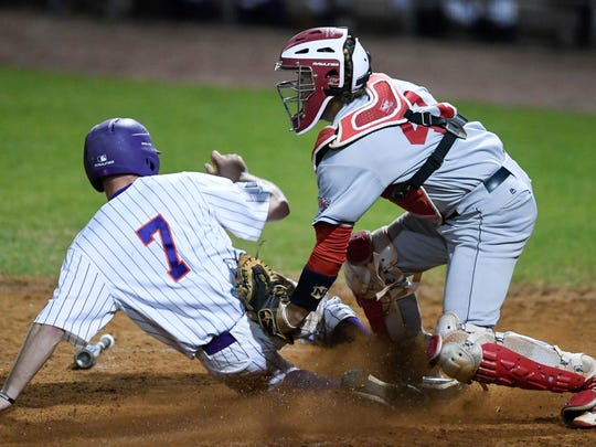 University of Evansville's Stewart Nelson (7) misses the tag from University of Southern Indiana catcher Logan Brown (41) and scores in the seventh inning as the University of Southern Indiana Screaming Eagles play the University of Evansville Aces at Evansville's Braun Stadium Wednesday, April 25, 2018.