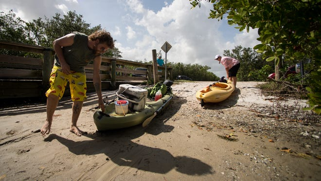 """Kimberly Davidson (right) and her brother, Jonathon Feigen, both of Vero Beach, use the canoe launch at the Oslo Road boat ramp Sunday, Feb. 11, 2018, in Vero Beach. """"I like this — it's shallow, and only smaller boats can really come in and out of here,"""" Davidson said, as family members prepared their small watercraft to head out and fish on the Indian River Lagoon. """"It's a nice little spot that we have, because otherwise, we've got to go all the way up to Wabasso."""" A proposed Oslo Road boat ramp project is on the agenda for the Indian River County Commission meeting at 9 a.m. on Tuesday."""