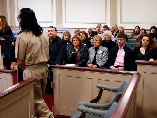 Convicted killer James Zarate walks past members of