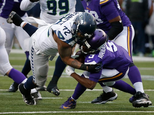 Seattle Seahawks defensive end Michael Bennett (72) sacks Minnesota Vikings quarterback Teddy Bridgewater (5) in the second half of an NFL football game in Minneapolis. The Cardinals play the battered Minnesota Vikings on Thursday in Arizona.