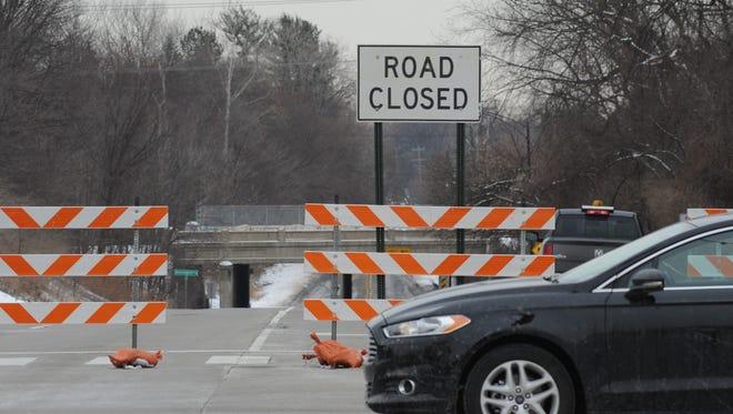 Barricades block traffic from motoring west along Big Beaver Road toward Woodward Avenue in Birmingham, Michigan on March 3, 2016.