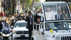 Pope Francis goes by hundreds of thousands of people