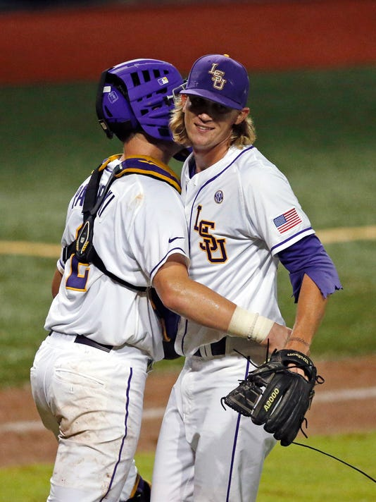 LSU pitcher Hunter Newman celebrates with catcher Michael Papierski (2) after they defeated Rice in a college baseball regional tournament in Baton Rouge, La., Sunday, June 5, 2016. LSU won 4-2. (AP Photo/Gerald Herbert)