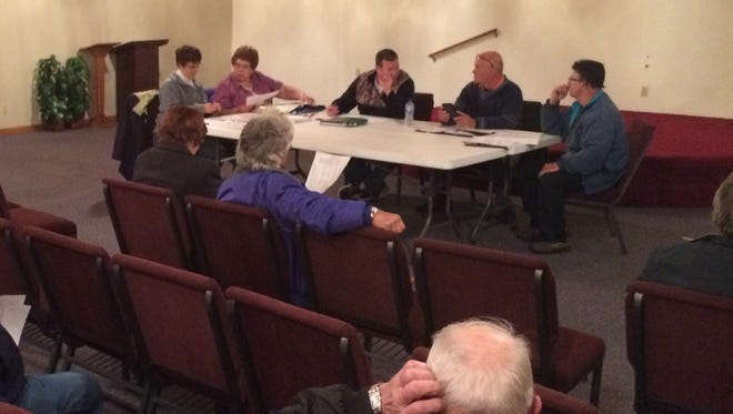 The Union Town Board met for the first time Tuesday in the newly acquired former Southern Door Community Church. Around the table from left are town Treasurer Denise Englebert, Clerk Rena LaLuzerne and board members Jeff LeGrave, Chairman John Bur and Bruce Alberts.