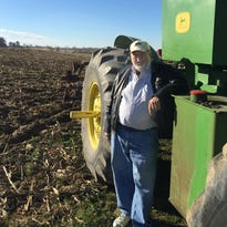 Keith Orebaugh, a fourth-generation corn farmer, poses by his farm at 9101 South 200 West, about 15 miles north of downtown Muncie.